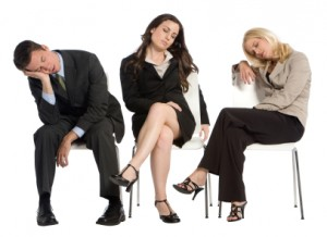 Image of three business professionals dozing in their chairs