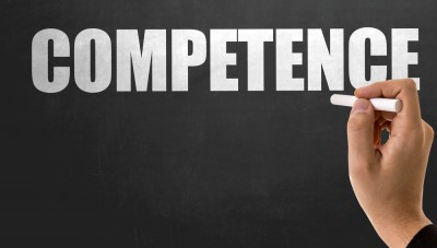 "The word ""competence"" on a blackboard"
