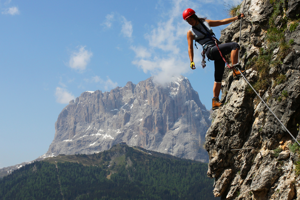 Mountain climber leading the way
