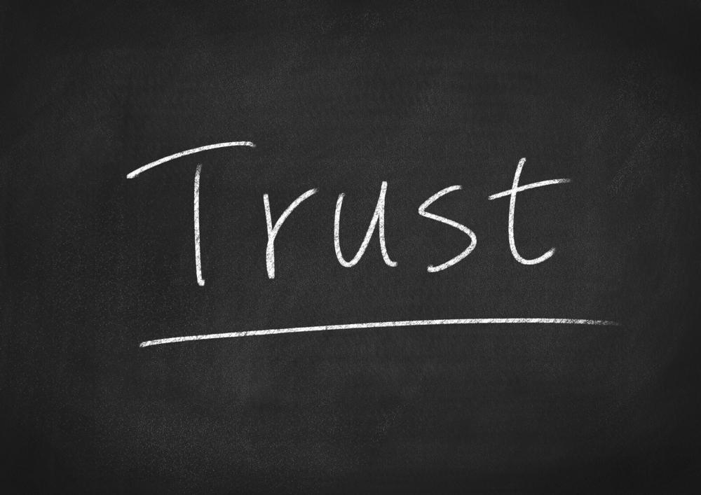 """Chalkboard with the word """"trust"""" written on it."""