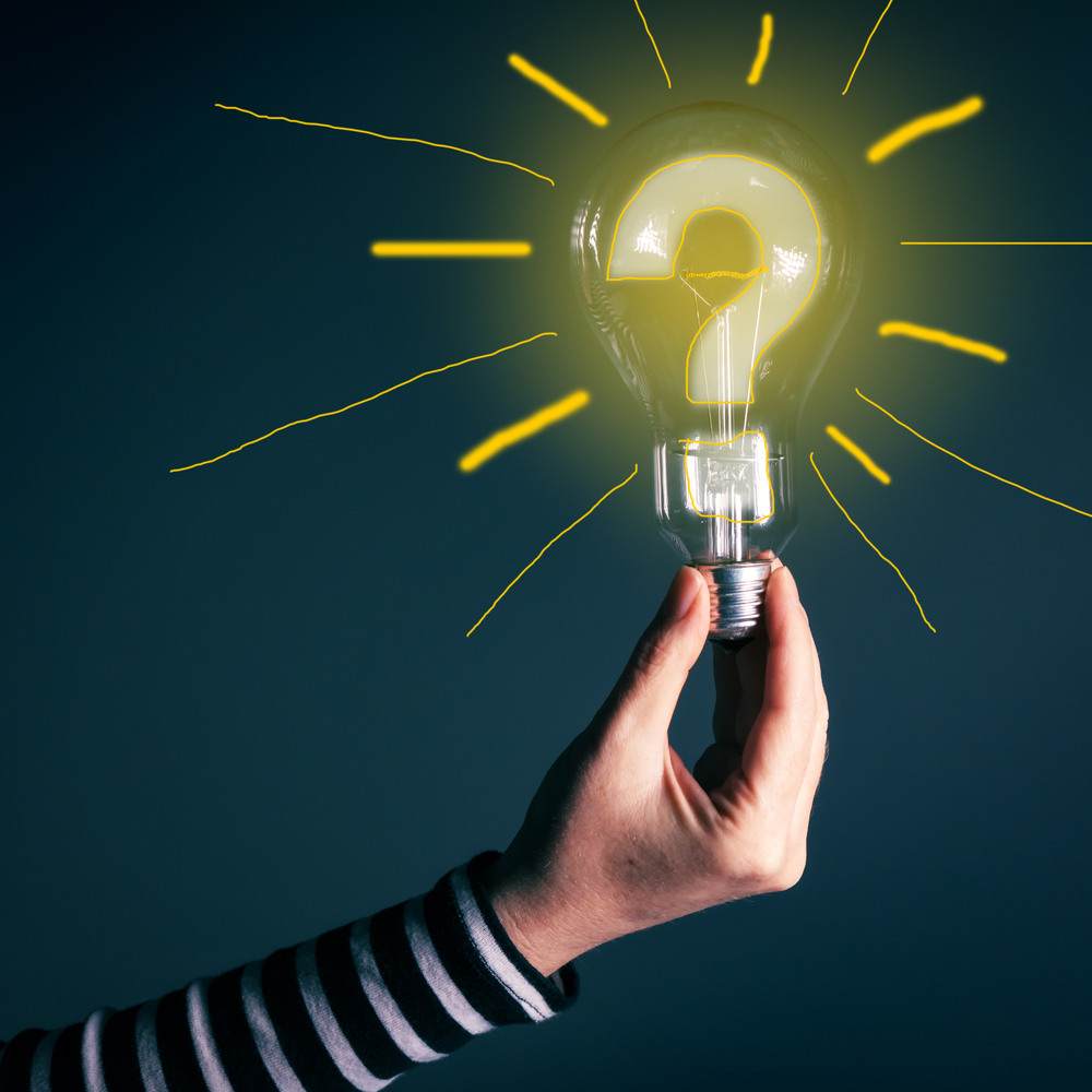 image of a person holding a lightbulb--the bulb has a question mark inside