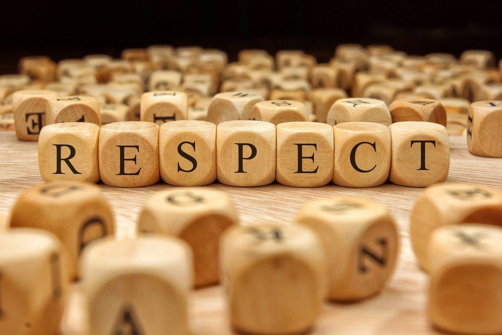 """wood tiles spelling out the word """"respect"""""""